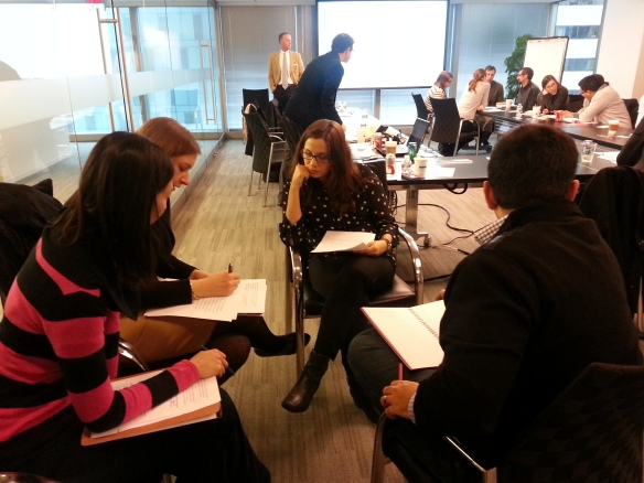 Participants review mock contracts and propose edits to problematic language.